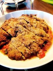 ビーフカツレツとフレッシュトマトのソースの写真