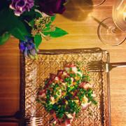 タコと梅肉、カラスミの前菜の写真