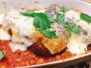 カニクリコロッケのチーズトマトソース焼きの写真