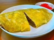 紹興酒風味ソース炒飯のオムライスの写真