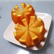 オレンジ飾り切り(上が平)の写真