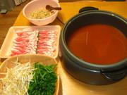 チゲ鍋の〆にトマトチーズリゾット!!の写真